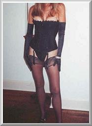 After Breast Augmentation and Anchor Lift Front View in Black Corset and Hose