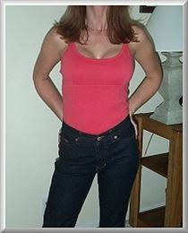 After Breast Augmentation Front View in Casual Clothes Month 2